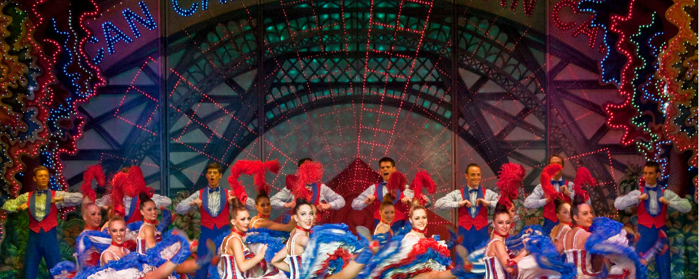ROBERT JULIAT'S ALICE DANCES AT PARIS' MOULIN ROUGE
