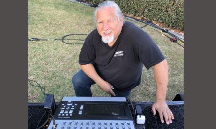 FOH ENGINEER LARRY SANCHEZ MIXES WITH QSC